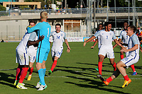 England players run to congratulate goalkeeper, Ryan Schofield and Ronaldo Vieira after winning the penalty shoot-out as they celebrate England's victory in the Toulon Tournament during England Under-18 vs Ivory Coast Under-20, Toulon Tournament Final Football at Stade de Lattre-de-Tassigny on 10th June 2017