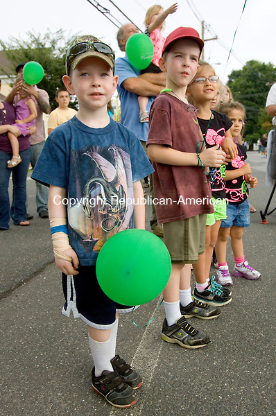NEWTOWN CT. 02 September 2013-090213SV11-From left, Connor Evans, 5, and his brother Aidan Evans, 7, both of Woodbury watch the 52nd Labor Day Parade in Newtown Monday.  The theme for this year&rsquo;s parade was &ldquo;We are Newtown&mdash;Marching Strong&rdquo;<br /> Steven Valenti Republican-American