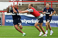 PICTURE BY ALEX WHITEHEAD/SWPIX.COM - Rugby League - England Training - Belle Vue Stadium, Wakefield, England - 02/07/12 -  Jamie Jones-Buchanan is tackled by Lee Mossop.