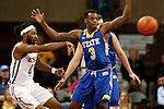 SIOUX FALLS, SD - NOVEMBER 26:  Chris Howell #3 from South Dakota State University defends as T.J. Cromer #0 from East Tennessee State University passes the ball during their game at the Sanford Pentagon Saturday evening in Sioux Falls. (Photo by Dave Eggen/Inertia)