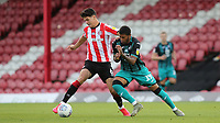 Christian Norgaard of Brentford tries to shake off a challenge from Swansea's Rhian Brewster during Brentford vs Swansea City, Sky Bet EFL Championship Play-Off Semi-Final 2nd Leg Football at Griffin Park on 29th July 2020