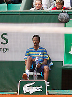 31-05-13, Tennis, France, Paris, Roland Garros,  Gael Monfils sits on a linesman chair