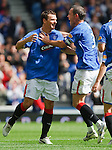 Lee McCulloch races off to celebrate his goal with David Weir
