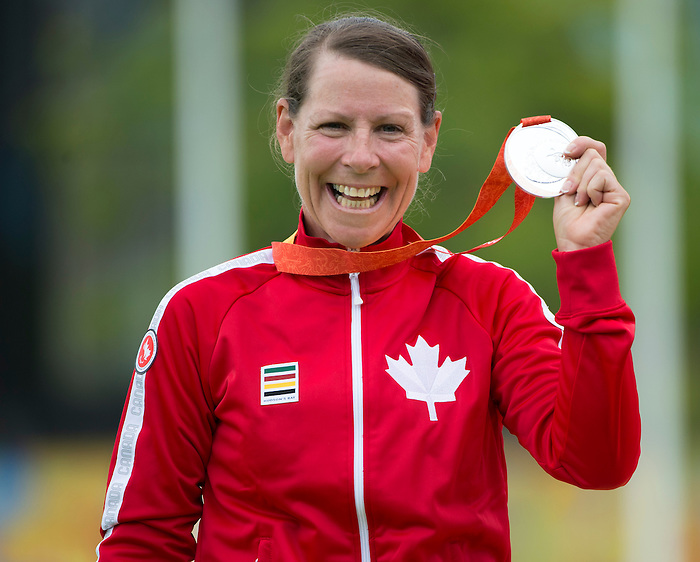 TORONTO, ON, AUGUST 10, 2015. Medal Archery events at the ParaPan Am Games _ Karen Van Nest wins silver, and Kevin Evans in Bronze medal match.<br /> Photo: Dan Galbraith/Canadian Paralympic Committee