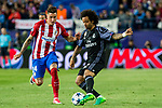 Marcelo Vieira of Real Madrid holds off pressure from  Jose Maria Gimenez of Atletico de Madrid during the match of Champions League between Atletico de Madrid and Real Madrid at Vicente Calderon Stadium in Madrid, May 10, 2017. Spain.