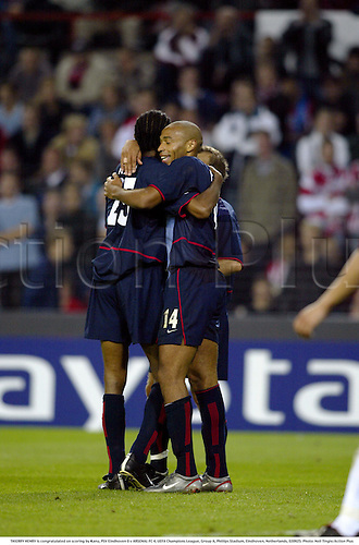 THIERRY HENRY is congratulated on scoring by Kanu, PSV Eindhoven 0 v ARSENAL FC 4, UEFA Champions League, Group A, Phillips Stadium, Eindhoven, Netherlands, 020925. Photo: Neil Tingle/Action Plus...2002.Football soccer player players.premiership premier league.congratulates congratulating.celebrate celebrates celebrating joy.................. ........................