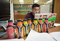 Bordered by sports drinks, Christian Lee '18 studies in the Academic Commons for his special topics in biology class, Dec. 9, 2015.<br />