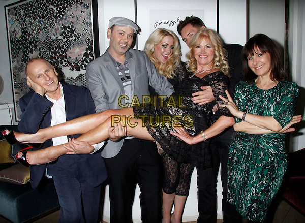 Debbie Moore, Wayne Sleep & Arlene Phillips with dancers .Debbie Moore, founder of Pineapple Dance Studios, celebrates her photograph being hosted in the Royal Academy of Art, London, England, UK, 16th June 2011..half length green print black lace picture  posing full being lifted carried .CAP/COA/CC.©CC/COA/Capital .