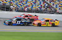 Jul. 3, 2008; Daytona Beach, FL, USA; NASCAR Sprint Cup Series drivers Denny Hamlin (11) leads Kasey Kahne (9) and Kevin Harvick (29) during practice for the Coke Zero 400 at Daytona International Speedway. Mandatory Credit: Mark J. Rebilas-