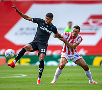 27th June 2020; Bet365 Stadium, Stoke, Staffordshire, England; English Championship Football, Stoke City versus Middlesbrough; James Chester of Stoke City pulls the arm of Ashley Fletcher of Middlesbrough