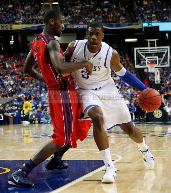 ATLANTA, GA. -  Terrence Jones is guarded by Terrance Henry during the second round of the SEC Men's Basketball Tournament between Kentucky and Ole Miss , played at the Georgia Dome, Friday, March 11, 2011.  Photo by Latara Appleby | Staff