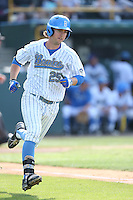 Chris Keck (25) of the UCLA Bruins runs to first base during a game against the Arizona Wildcats at Jackie Robinson Stadium on May 16, 2015 in Los Angeles, California. UCLA defeated Arizona, 6-0. (Larry Goren/Four Seam Images)