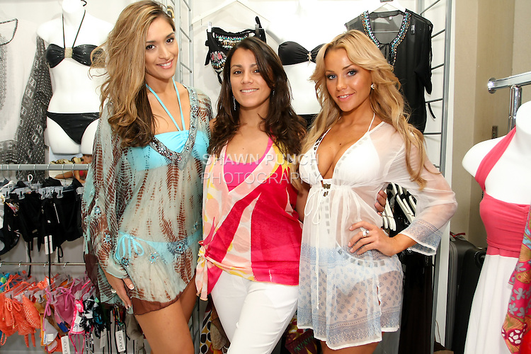 9e539656792df Designer Kariza Luiza (center) poses with models during the CURVENY  Designer Lingerie & Swim