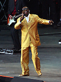 "Al Green performs at  RFK Stadium in Washington, DC on October 21, 2001 for the ""United We Stand"" Concert.  The concert raised at least 2 million dollars for the Pentagon Relief Fund, the American Red Cross Liberty Relief Fund and Salvation Army Relief Fund, all of which are aiding recovery from the September 11 attacks. .Credit: Ron Sachs / CNP"
