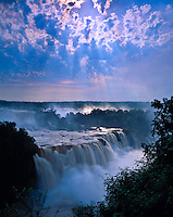 Cloud Rays at Iguazu Falls, Iguazu Falls National Park, Brazil   Huge waterfall in tropical rainforest of south Brazil