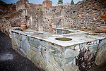 A restaurant counter in a tavern in the ancient city of Pompeii, Italy