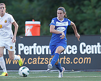 Boston Breakers midfielder Heather O'Reilly (9) passes the ball.  In a National Women's Soccer League (NWSL) match, Boston Breakers (blue) tied Western New York Flash (white), 2-2, at Dilboy Stadium on August 3, 2013.