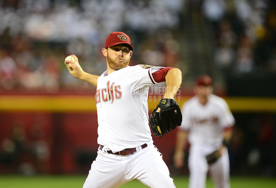 May 8, 2012; Phoenix, AZ, USA; Arizona Diamondbacks pitcher Ian Kennedy throws in the fifth inning against the St. Louis Cardinals at Chase Field. Mandatory Credit: Mark J. Rebilas-