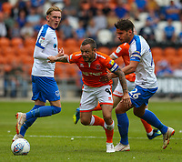 Blackpool's Jay Spearing vies for possession with Portsmouth's Gareth Evans<br /> <br /> Photographer Alex Dodd/CameraSport<br /> <br /> The EFL Sky Bet League One - Blackpool v Portsmouth - Saturday August 11th 2018 - Bloomfield Road - Blackpool<br /> <br /> World Copyright &copy; 2018 CameraSport. All rights reserved. 43 Linden Ave. Countesthorpe. Leicester. England. LE8 5PG - Tel: +44 (0) 116 277 4147 - admin@camerasport.com - www.camerasport.com