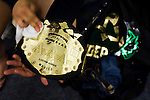 Lucha Libre AAA wrestler Joe Lider polishes his championship belt before a match in Sacramento, CA March 28, 2009.