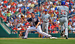 3 September 2012: Washington Nationals first baseman Adam LaRoche makes a lay at first base during a game against the Chicago Cubs at Nationals Park in Washington, DC. The Nationals edged out the visiting Cubs 2-1, in the first game of heir 4-game series. Mandatory Credit: Ed Wolfstein Photo