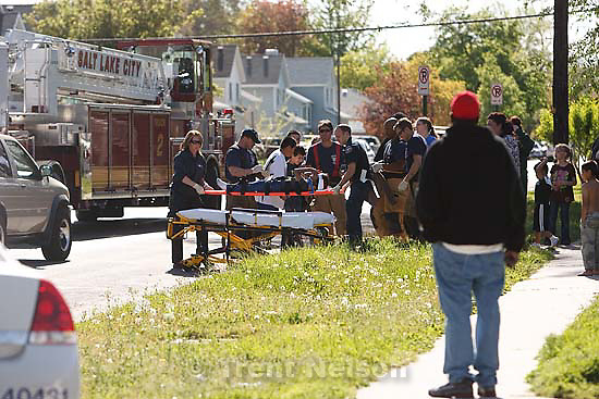 Salt Lake City - Emergency workers with a young victim at the scene of an auto vs. bike accident at 500 South, 940 West Thursday May 7, 2009..