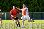 Seam McAulliffe Brosna gets in his shot under pressure from Anthony Wharton Fossa during their Div 5 clash in Brosna on Sunday