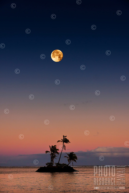 Full moon over tiny island at dusk, creating a tranquil and romantic setting.