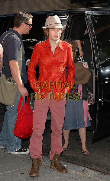 BECK.Arrives at the Ed Sullivan Theater to tape his appearance at the Dave Letterman show in Manhattan, New York, New York.  .October 3rd, 2005.Photo Credit: Patti Ouderkirk/AdMedia/Capital Pictures.Ref: PO/ADM/CAP.full length brown boots pink trousers red shirt hat.www.capitalpictures.com.sales@capitalpictures.com.© Capital Pictures.