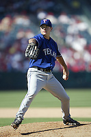 C.J. Nitkowski of the Texas Rangers pitches during a 2002 MLB season game against the Los Angeles Angels at Angel Stadium, in Los Angeles, California. (Larry Goren/Four Seam Images via AP Images)