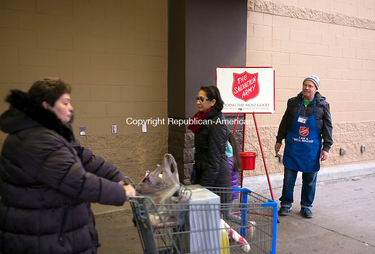 Waterbury, CT- 09 December 2015-120915CM08- Scott Ritchie, a kettle worker with the Salvation Army, rings a bell outside Walmart in Waterbury on Wednesday   Ritchie was collected donations for the Salvation Army, which provides to those in need, among other charitable efforts. Christopher Massa Republican-American