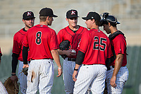 Kannapolis Intimidators pitching coach Matt Zaleski (25) has a meeting on the mound with starting pitcher Jimmy Lambert (middle), third baseman Zach Remillard (8), first baseman Brandon Dulin (31), ands catcher Seby Zavala (21) during the game against the Hagerstown Suns at Kannapolis Intimidators Stadium on June 14, 2017 in Kannapolis, North Carolina.  The Intimidators defeated the Suns 4-1 in game one of a double-header.  (Brian Westerholt/Four Seam Images)