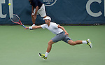 Alex Kuznetsov (USA) loses to John Isner (USA) 7-6(2), 7-6(4) at the CitiOpen in Washington, D.C., Washington, D.C.  District of Columbia on July 31, 2013.