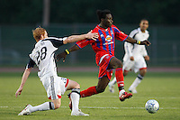 Crystal Palace forward Gary Brooks (30) and New England Revolution defender Pat Phelan (28). The New England Revolution (MLS) defeated Crystal Palace FC USA of Baltimore (USL2) 5-3 in penalty kicks after finishing regulation and overtime tied at 1-1 during a Lamar Hunt US Open Cup quarterfinal match at Veterans Stadium in New Britain, CT, on July 8, 2008.