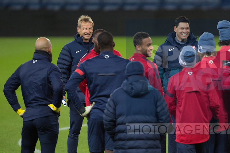 USA manager Jurgen Klinsmann gathers his side around him - USA Press Conference - International Friendly - Hampden Park - Glasgow - 14/11/2013 Pic Philip Oldham/Sportimage