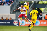 Thierry Henry (14) of the New York Red Bulls goes up for a header with Eric Gehrig (16) of the Columbus Crew during the first half during a Major League Soccer (MLS) match at Red Bull Arena in Harrison, NJ, on May 26, 2013.