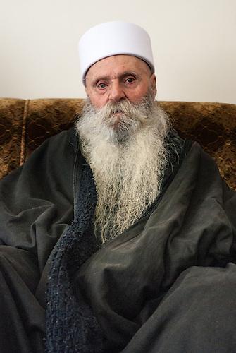 Plateau du Golan, dans la zone tampon entre la Syrie et Israel, Jan 2011. Salih Farhat, de la comunaute Druze vivant en territoire du Golan occupe par Israel, le jour du mariage de son fils Nabih avec Samar, une druze Syrienne.