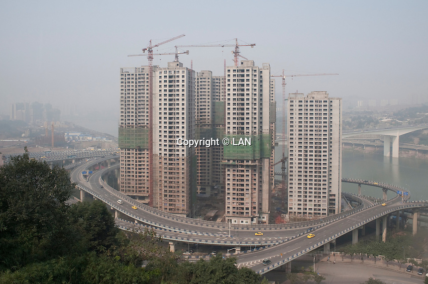 Commercial Real Estate Development Development Viewed From Metro Line 2 in Chongqing, China.  © LAN