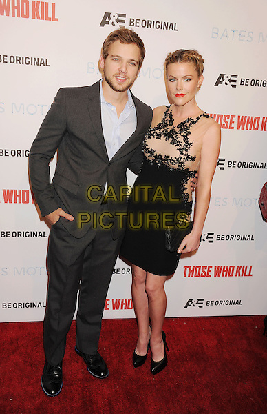 LOS ANGELES, CA- FEBRUARY 26: Actors Max Thieriot (L) and Kathleen Robertson arrive at the premiere party for A&amp;E's Season 2 of 'Bates Motel' and the series premiere of 'Those Who Kill' at Warwick on February 26, 2014 in Los Angeles, California.<br /> CAP/ROT/TM<br /> &copy;Tony Michaels/Roth Stock/Capital Pictures
