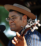 Dom Flemons, singing in the Toshi Seager stage on Hoot Hill, on the third-and-final day of the 4th Annual Summer Hoot Festival, held at the Ashokan Center in Olivebridge, NY, on Sunday, August 28, 2016. Photo by Jim Peppler; Copyright Jim Peppler 2016.
