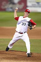 Auburn Doubledays pitcher Travis Henke #33 delivers a pitch during game one of the NY-Penn League Championship Series against the Staten Island Yankees at Falcon Park on September 12, 2011 in Auburn, New York.  Staten Island defeated Auburn 9-2.  (Mike Janes/Four Seam Images)