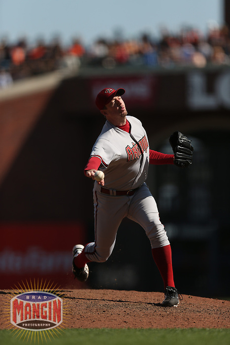 SAN FRANCISCO - SEPTEMBER 27:  Brad Ziegler of the Arizona Diamondbacks pitches during the game against the San Francisco Giants at AT&T Park on September 27, 2012 in San Francisco, California. (Photo by Brad Mangin)