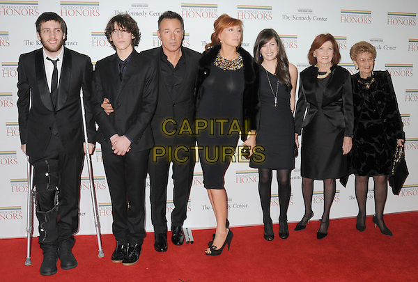 BRUCE SPRINGSTEEN,  PATTI SCIALFA SPRINGSTEEN & family .Gala Dinner honoring the 32nd Kennedy Center Honors held at the State Department, Washington DC, USA, .5th December 2009..full length black suit dress fur jacket coat married husband wife open toe shoes heels bows clutch bag children kids crutches .CAP/ADM/LF.©Laura Farr/Admedia/Capital Pictures