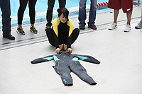 NWA Democrat-Gazette/J.T. WAMPLER Lindsay Scott of Farmington sets a Guinness World Record for the fastest time to put on and take off a wetsuit Sunday Nov. 5, 2017 in Fayetteville. Scott performed the feat in front of expert witnesses in fields including law enforcement, legal, and swimming and an official time was recorded. She is submitting the record at 43.13 seconds.