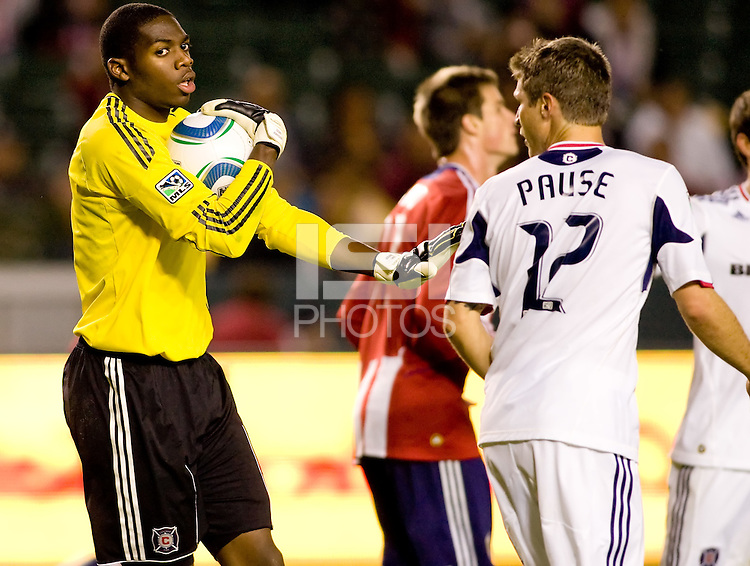Goalkeeper Sean Johnson of the Chicago Fire holds the ball in front of teammate Logan Pause (12). The Chicago Fire defeated CD Chivas USA 3-1 at Home Depot Center stadium in Carson, California on Saturday October 23, 2010.
