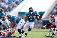 November 08, 2009:    Jacksonville Jaguars running back Rashad Jennings (23) breaks through a hole on his way to a touchdown during first half action between the AFC West  Kansas City Chiefs and AFC South Jacksonville Jaguars at Jacksonville Municipal Stadium in Jacksonville, Florida............