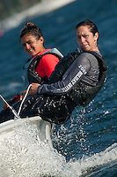 Salve Regina's Kelsey Bell,'15, right, with crew Angelina Todaro,'16, take on some rough water as they practice in Narragansett Bay.