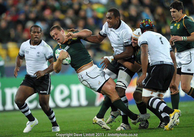 Frans Steyn tries to twist out of the tackle of Fiji's Leone Nakarawa during the South Africa versus Fiji pool D match of the 2011 IRB Rugby World Cup at Wellington Regional Stadium, Wellington, New Zealand on Saturday, 17 September 2011. Photo: Dave Lintott / lintottphoto.co.nz