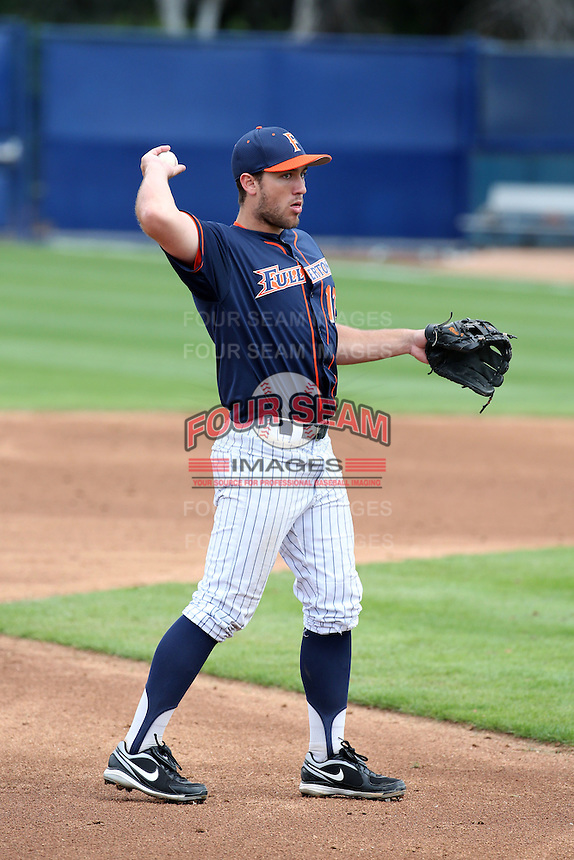 Timmy Richards (13) of the Cal State Fullerton Titans makes a throw during a game against the Wichita State Shockers at Goodwin Field on March 13, 2016 in Fullerton, California. Cal State Fullerton defeated Wichita State, 7-1. (Larry Goren/Four Seam Images)