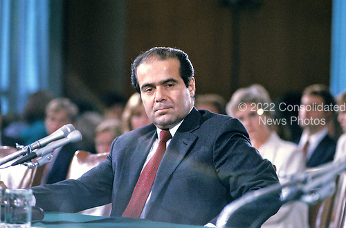 Judge Anthony Scalia of the United States Court of Appeals for the District of Columbia Circuit, testifies before the US Senate Judiciary Committee on his nomination by US President Ronald Reagan to be Associate Justice of the Supreme Court of the United States in Washington, DC on August 5, 1986.<br /> Credit: Arnie Sachs / CNP